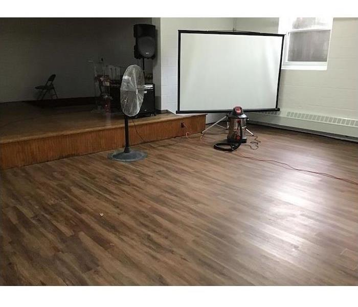 Wood stage and floor with water damage