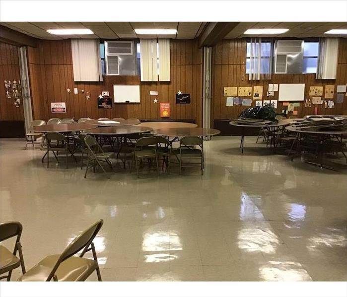 Clean cafeteria with tables and chairs
