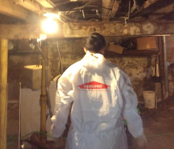 SERVPRO technician wearing PPE gear during sewage water damage mitigation