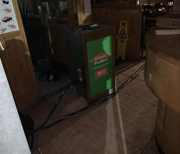 Restaurant with fire damage and SERVPRO equipment running