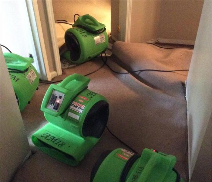 "Green Air Movers ""Floating"" a Carpet for Drying"